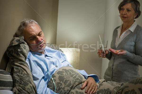 Ill old male patient and caring wife Stock photo © CandyboxPhoto