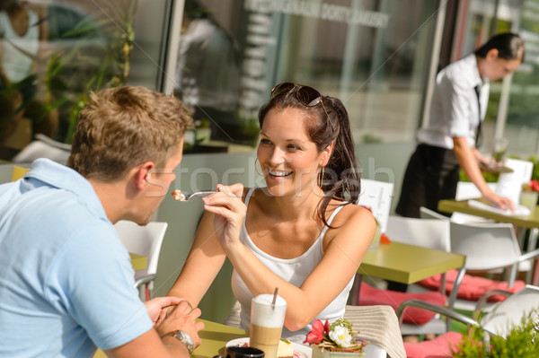 Woman feeding man cheesecake at cafe couple Stock photo © CandyboxPhoto