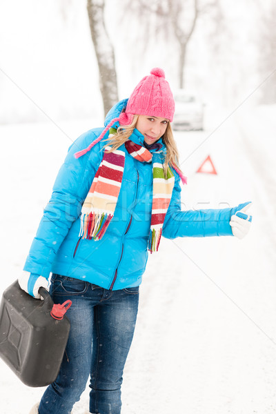 Woman hitchhiking on road snow gas can Stock photo © CandyboxPhoto