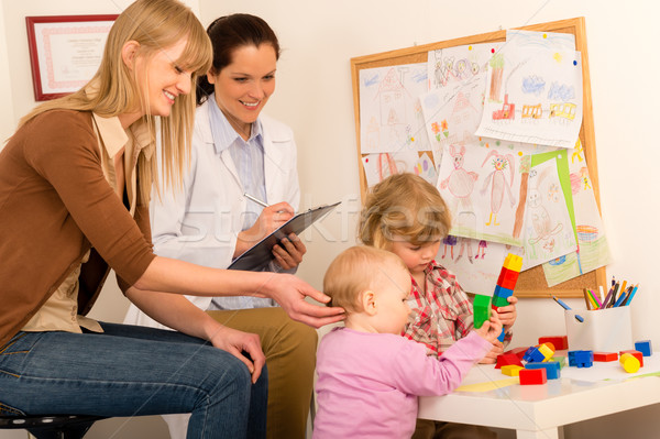 Pediatrician female observe children play activity Stock photo © CandyboxPhoto