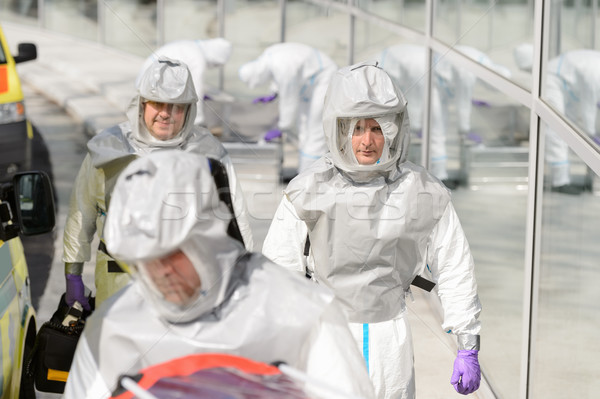 Biohazard medical team in protective uniform Stock photo © CandyboxPhoto