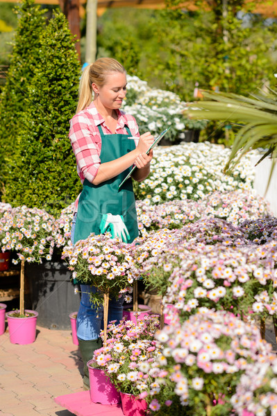 Garden center woman write notes potted flowers Stock photo © CandyboxPhoto