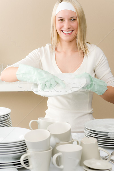 Stock photo: Modern kitchen - happy woman washing dishes