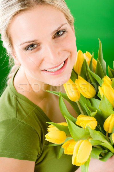 Young woman hold yellow tulips flower Stock photo © CandyboxPhoto