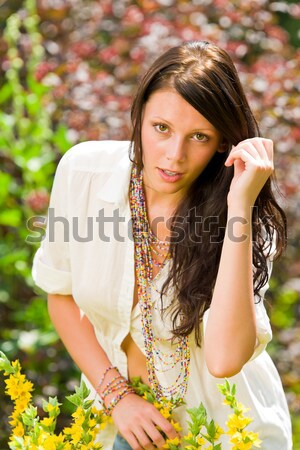 Beautiful woman sunny garden care yellow flowers Stock photo © CandyboxPhoto