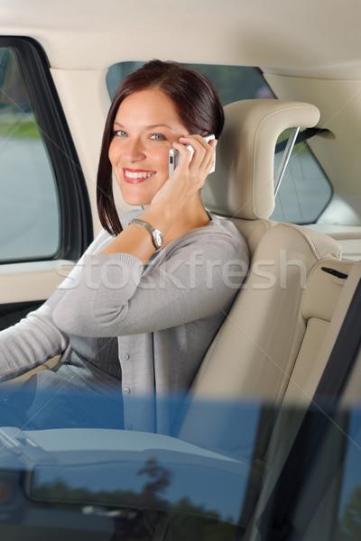 Executive businesswoman sit car backseat calling Stock photo © CandyboxPhoto