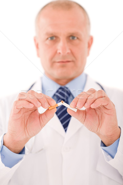 Stop smoking mature male doctor break cigarette Stock photo © CandyboxPhoto