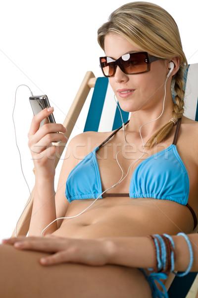 Foto d'archivio: Spiaggia · felice · donna · relax · bikini · musica