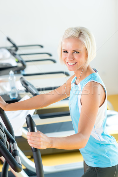 Fitness young woman on elliptical cross trainer Stock photo © CandyboxPhoto