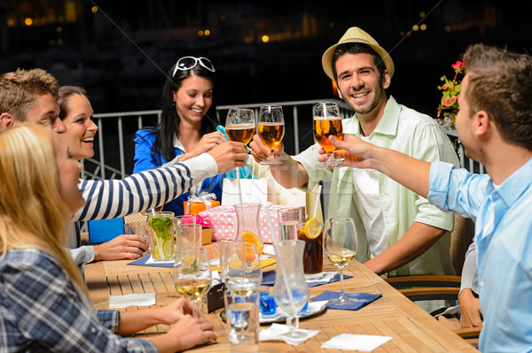 Group of young friends drinking beer outdoors Stock photo © CandyboxPhoto