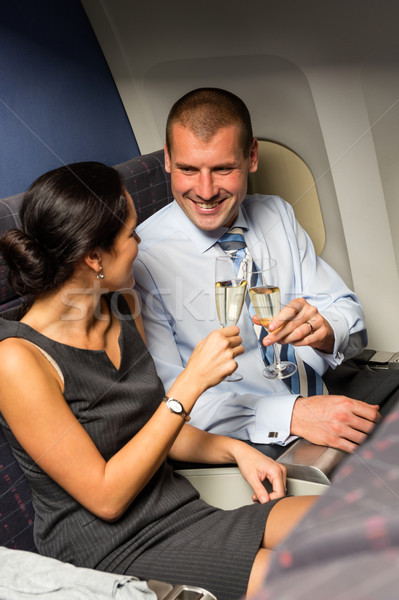 Smart couple travel by airplane toasting champagne Stock photo © CandyboxPhoto