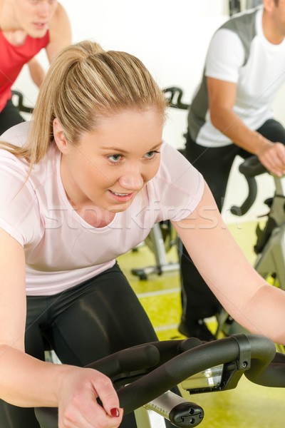 Young woman at bike spinning class Stock photo © CandyboxPhoto