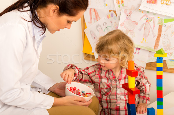 Pediatrician give lolly to little child girl Stock photo © CandyboxPhoto