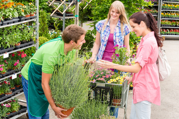 Garden centre salesman offer potted plant Stock photo © CandyboxPhoto