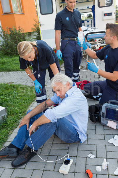 Emergency team giving help to injured man Stock photo © CandyboxPhoto