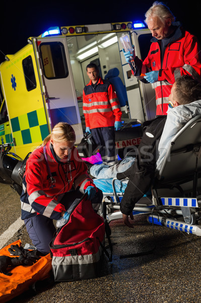Paramedic team assisting injured motorbike driver Stock photo © CandyboxPhoto