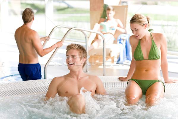 Piscina relajarse bañera de hidromasaje jóvenes atractivo Foto stock © CandyboxPhoto