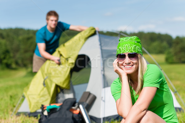 Camping couple build-up tent sunny countryside Stock photo © CandyboxPhoto