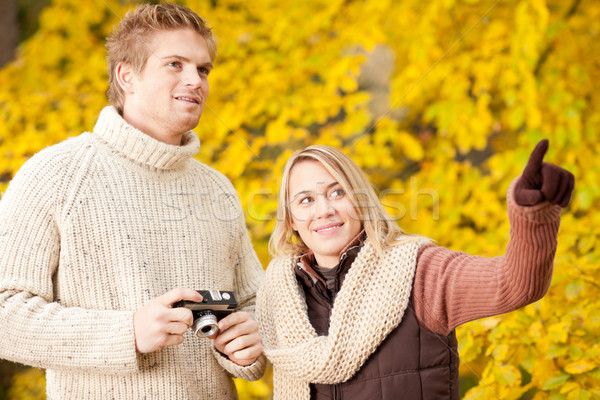 Autumn couple take photo camera in park Stock photo © CandyboxPhoto