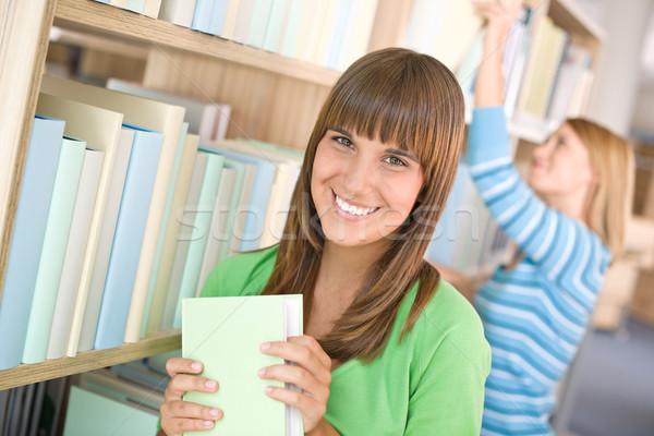 Stockfoto: Student · bibliotheek · twee · vrouw · kiezen · boek
