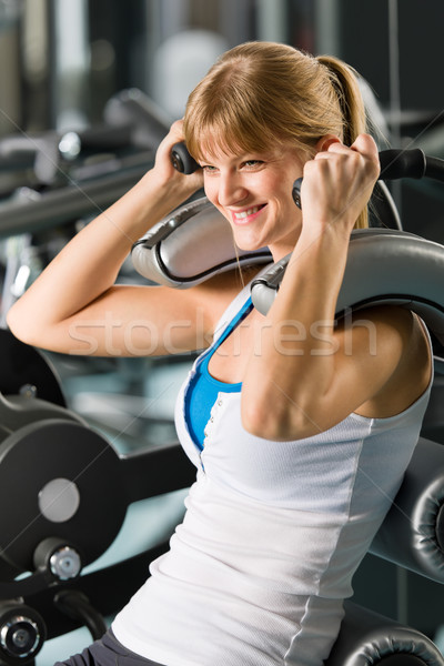 Young woman at fitness center exercise abdominal Stock photo © CandyboxPhoto