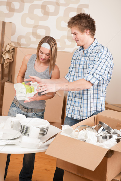 Moving house: Young couple unpacking kitchen dishes Stock photo © CandyboxPhoto