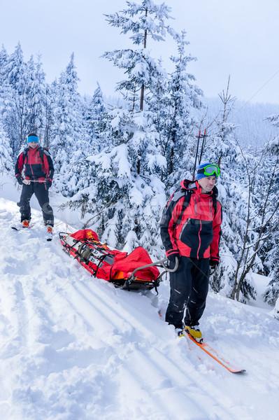 Ski patrol transporting injured skier snow forest Stock photo © CandyboxPhoto