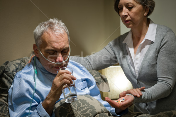 Senior man taking medication with water Stock photo © CandyboxPhoto