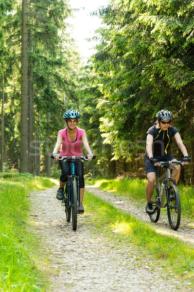 Joyful biker couple in woods Stock photo © CandyboxPhoto