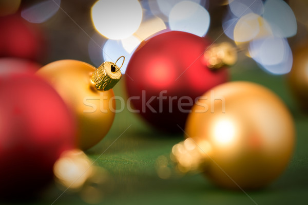 Gold and red christmas baubles on green Stock photo © CandyboxPhoto