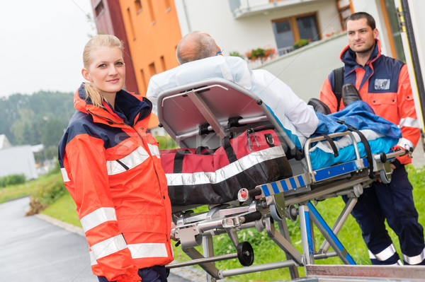 Patient on stretcher with paramedics emergency aid Stock photo © CandyboxPhoto