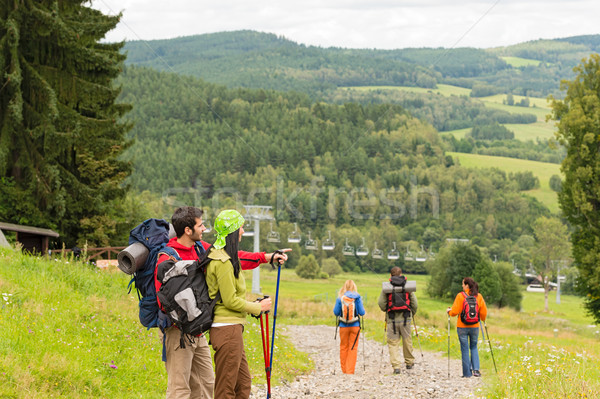 Young hikers enjoying scenic view on mountain Stock photo © CandyboxPhoto
