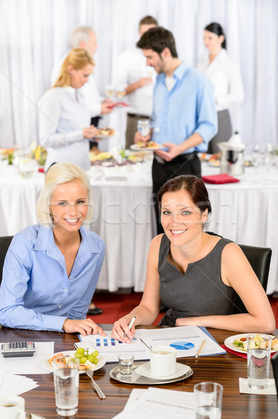 Two business women work during catering buffet Stock photo © CandyboxPhoto