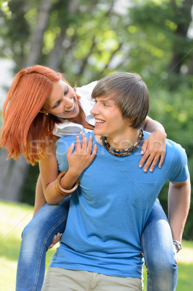 Man give piggyback ride to girlfriend park Stock photo © CandyboxPhoto