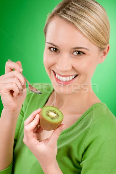 Egészséges életmód boldog nő tart kiwi teáskanál Stock fotó © CandyboxPhoto
