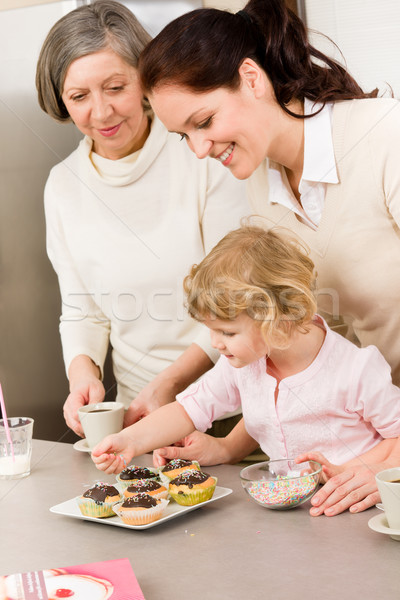 Daughter and mother decorating cupcakes sprinkles Stock photo © CandyboxPhoto