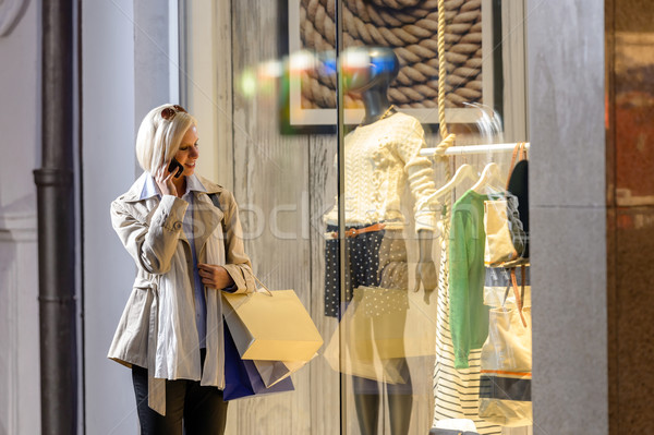Young woman window shopping evening city Stock photo © CandyboxPhoto
