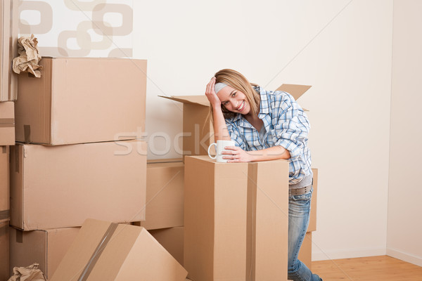 Moving house: Woman with box in new home Stock photo © CandyboxPhoto