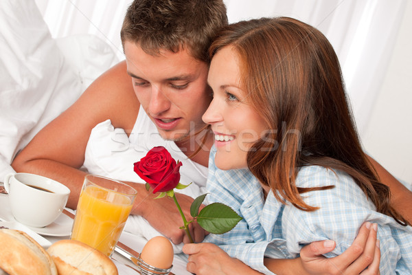 Happy Man And Woman Having Breakfast In Bed Together Stock -6588