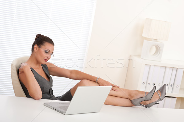 Female manager working with legs up Stock photo © CandyboxPhoto