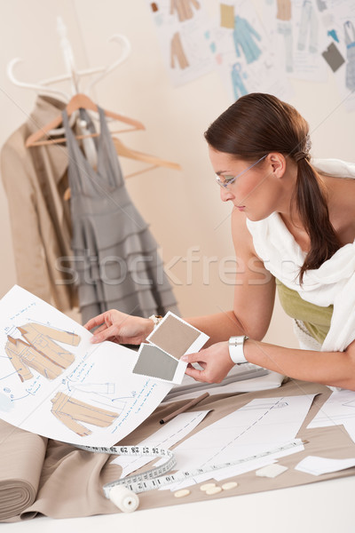 Female fashion designer working with sketches Stock photo © CandyboxPhoto