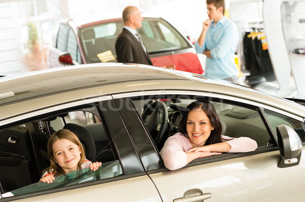 Mother and daughter trying car in dealership Stock photo © CandyboxPhoto