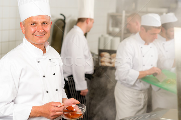 Professional kitchen smiling chef add spice food Stock photo © CandyboxPhoto