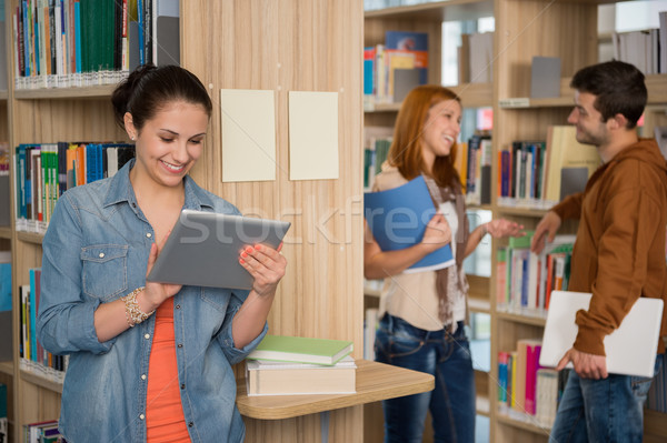University student looking at tablet in library Stock photo © CandyboxPhoto