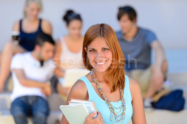 Summer college student girl smiling friends behind Stock photo © CandyboxPhoto