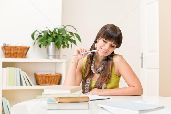 Foto stock: Adolescente · menina · casa · estudante · escrever · lição · de · casa