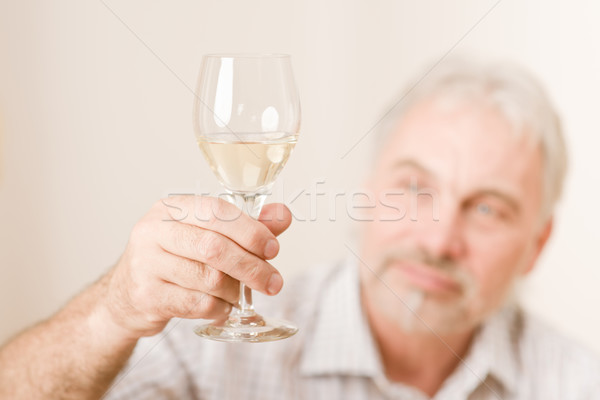 Senior mature man with glass of white wine Stock photo © CandyboxPhoto