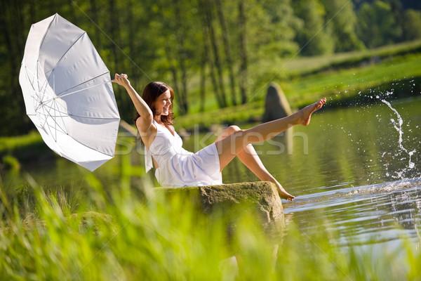 Boldog romantikus nő ül tó csobbanás Stock fotó © CandyboxPhoto