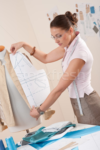 Female fashion designer working with pattern cutting Stock photo © CandyboxPhoto