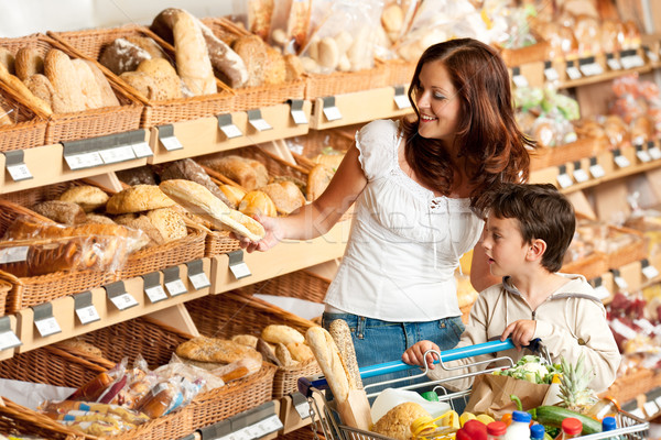 Stock photo: Grocery store shopping - Brown hair woman with child